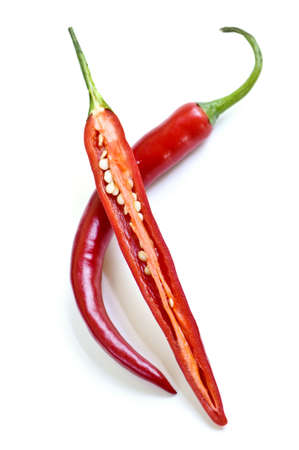 two and a half: Red hot chili peppers isolated on white background