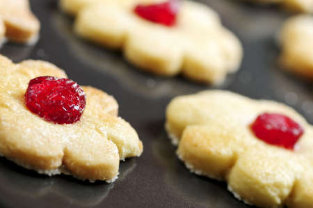 nonstick: Fresh shortbread cookies on a baking tray