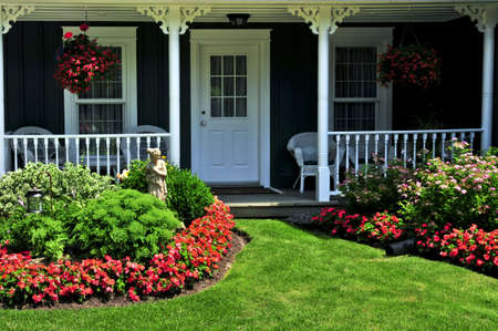 appeals: Landscaped front yard of a house with flowers and green lawn Stock Photo