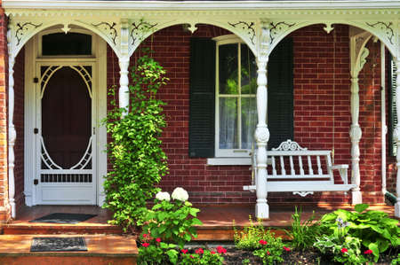 architectural exterior: Beautiful porch of victorian house decorated with flowers