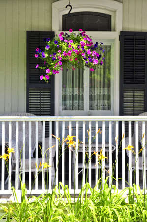 Beautiful porch of victorian house decorated with flowers