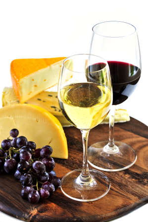 Wineglasses with red and white wine and assorted cheeses Stock Photo - 3486294