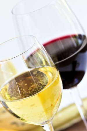 white wine: Glasses of red and white wine close up