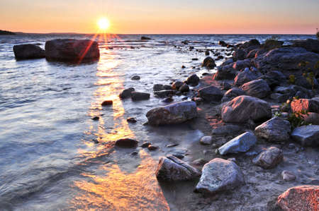 great bay: Sunset at the rocky shore of Georgian Bay, Canada. Awenda provincial park. Stock Photo