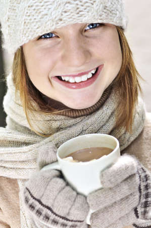Teenage girl in winter hat with cup of hot chocolate Stock Photo - 3544291