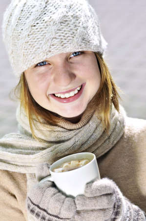 Teenage girl in winter hat with cup of hot chocolate Stock Photo - 3544242