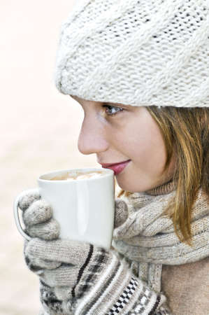 Teenage girl in winter hat with cup of hot chocolate Stock Photo - 3544220