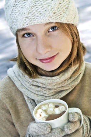 Teenage girl in winter hat with cup of hot chocolate Stock Photo - 3544241