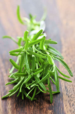 natural selection: Bunch of fresh herb rosemary close up on wooden cutting board Stock Photo