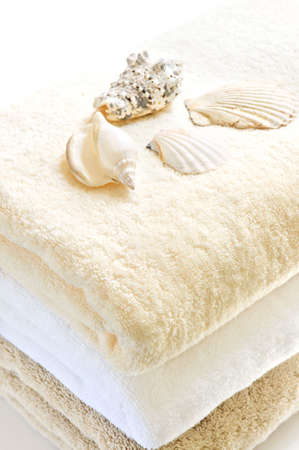 Stack of soft towels isolated on white background photo