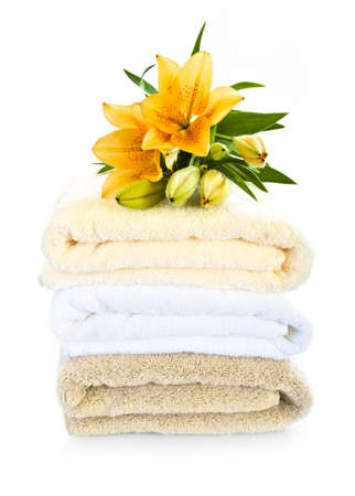 Stack of soft towels isolated on white background