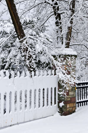 Fence in winter park covered with fresh snow photo