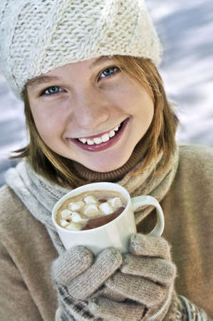 Teenage girl in winter hat with cup of hot chocolate Stock Photo - 3561865
