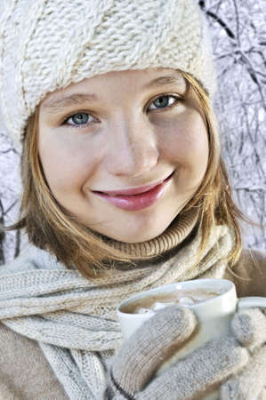 Teenage girl in winter hat with cup of hot chocolate Stock Photo - 3561869