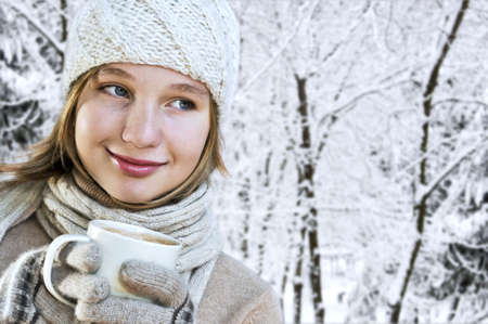 Teenage girl in winter hat with cup of hot chocolate Stock Photo - 3561866