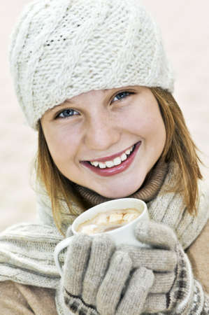 Teenage girl in winter hat with cup of hot chocolate Stock Photo - 3571948