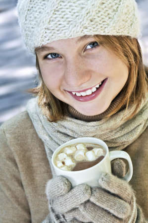 Teenage girl in winter hat with cup of hot chocolate Stock Photo - 3571953