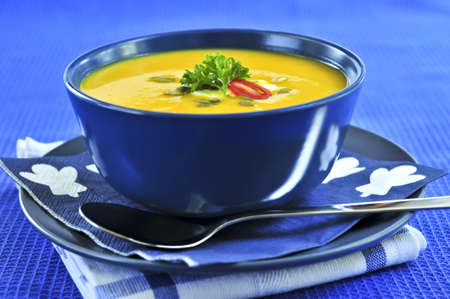 Pumpkin or squash soup in a bowl photo