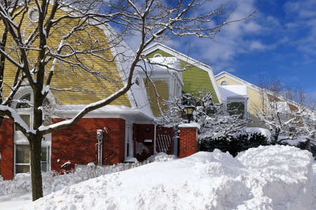 Winter street with lots of snow and colorful houses in Toronto photo