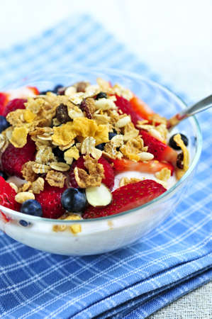 Serving of yogurt with fresh berries and granola photo