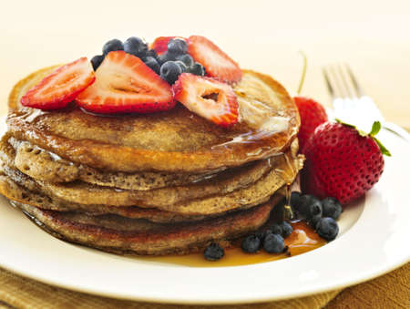crepe: Stack of buckwheat pancakes with fresh berries and maple syrup