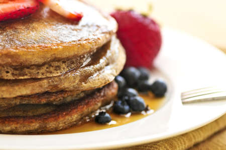 buckwheat: Stack of buckwheat pancakes with fresh berries and maple syrup