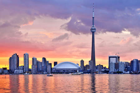 building cn tower: Scenic view at Toronto city waterfront skyline at sunset Editorial