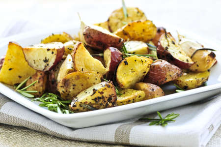 served: Herb roasted potatoes served on a plate Stock Photo