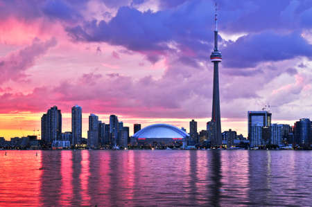 building cn tower: Scenic view at Toronto city waterfront skyline at sunset Stock Photo