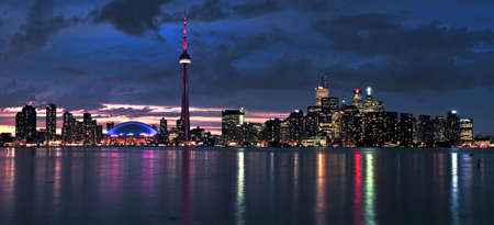 highrises: Scenic view at Toronto city waterfront skyline at sunset Stock Photo
