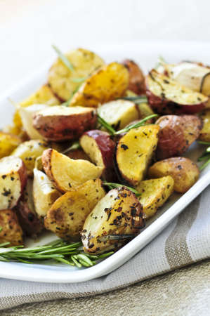 starchy food: Herb roasted potatoes served on a plate Stock Photo