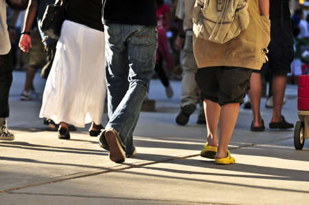 the pavement: Crowd of people walking on a street Stock Photo