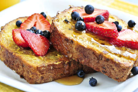 toast bread: Breakfast of french toast with fresh berries and maple syrup