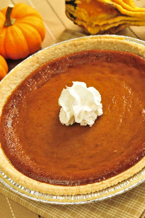 Whole pumpkin pie with fresh whipped cream Stock Photo - 3723318