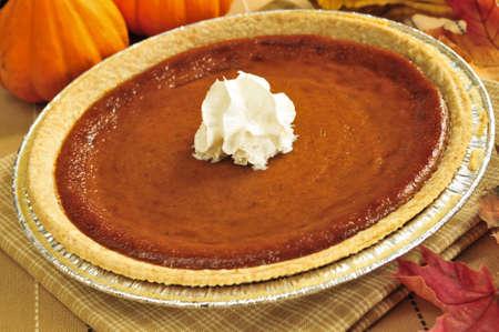 pumpkin pie: Whole pumpkin pie with fresh whipped cream Stock Photo