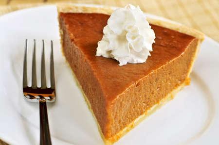 pumpkin pie: Slice of pumpkin pie with fresh whipped cream