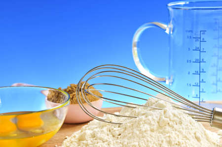 ingredient: Flour, whisk and eggs in a bowl, baking ingredients Stock Photo