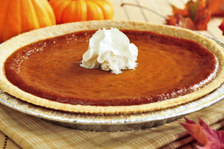 Whole pumpkin pie with fresh whipped cream Stock Photo - 3743728