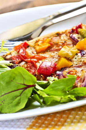 Vegetarian meal of vegetable pizza and green salad photo
