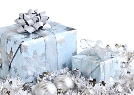 Wrapped gift boxes with silver Christmas ornaments on white background
