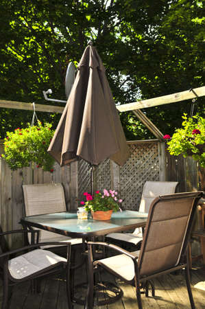 garden furniture: Wooden deck of a house with patio furniture