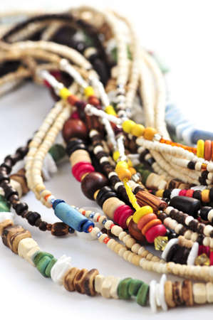natural selection: Wood and seashell bead necklaces close up