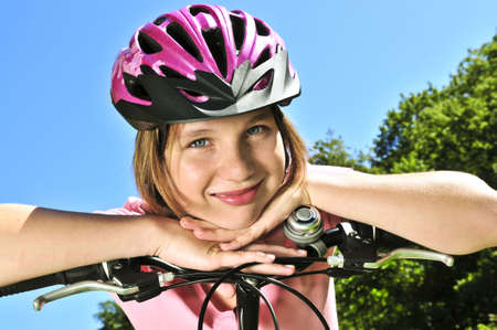 Portrait of a teenage girl on a bicycle in summer park outdoors Stock Photo - 3858478