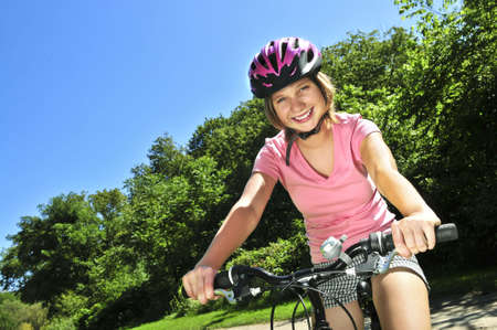 cycling   helmet: Portrait of a teenage girl on a bicycle in summer park outdoors