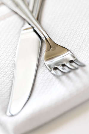 Fork and knife close up on white napkin photo