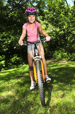 Portrait of a teenage girl on a bicycle in summer park outdoors Stock Photo - 3892019