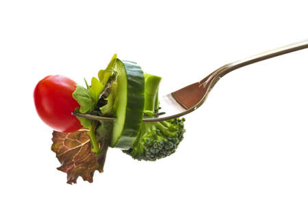 Fresh vegetables on a fork isolated on white background Stock Photo - 3891992
