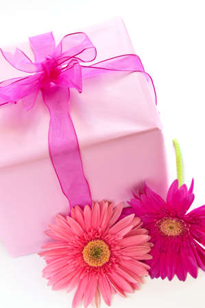 Gift box wrapped in pink paper with ribbon and bow