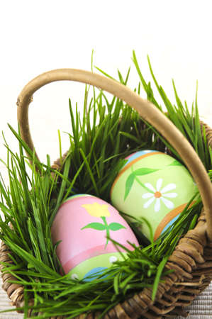 Easter eggs arrangement with green grass in a basket Stock Photo - 3903151