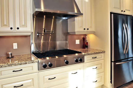 stove: Interior of modern luxury kitchen with stainless steel appliances